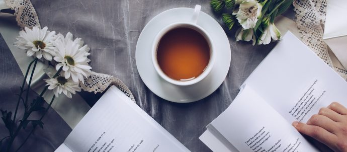 coffee cup and poetry books