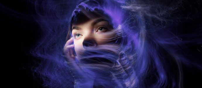 girl with weird space dust around face