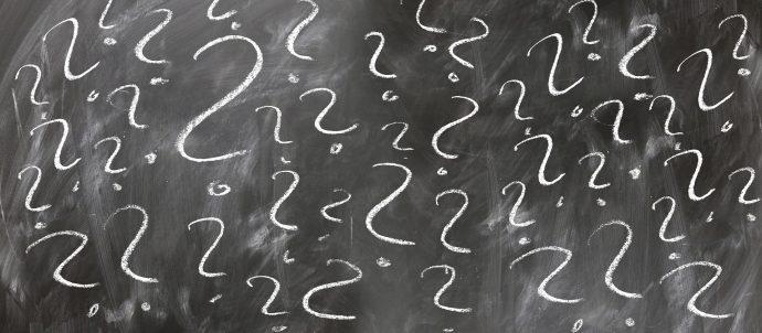 question marks on chalk board